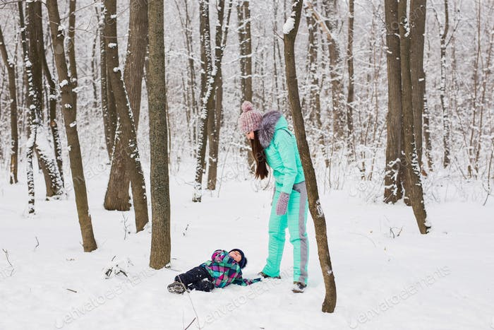 Mother and child girl on a winter walk in nature. Happy family