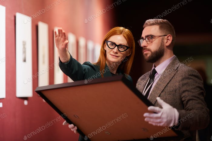 Business people working in gallery