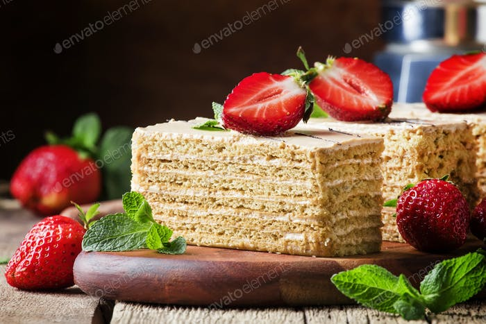 honey cake decorated with strawberries