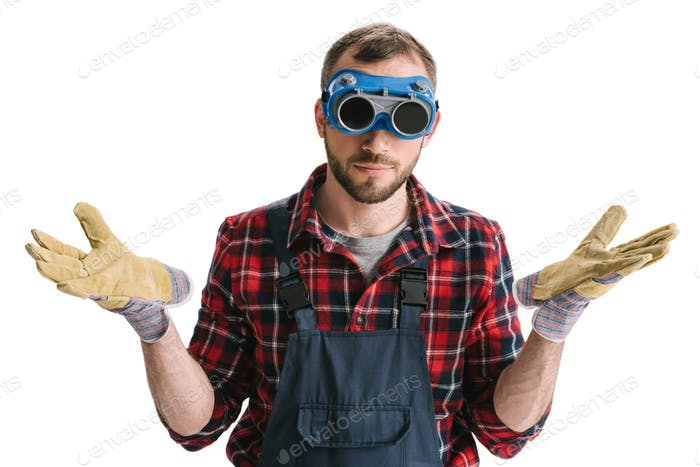 funny construction worker in welding glasses and gloves