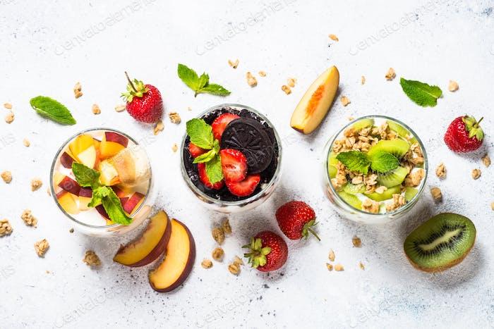 Fruit Dessert in glasses with yogurt and berries
