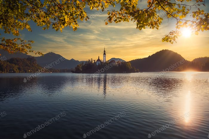 Scenic view of Lake Bled and island with church, colorful dramatic sky, Slovenia