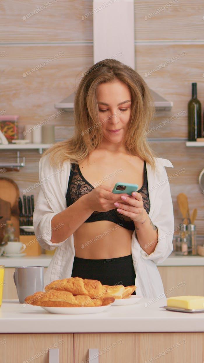 Woman in lingerie dancing in kitchen