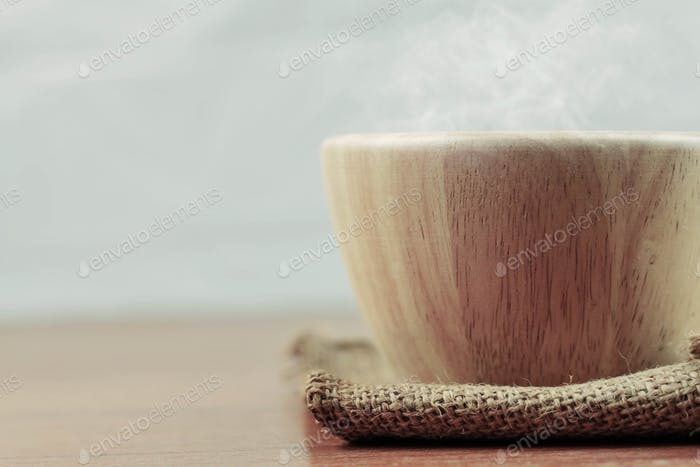 Wooden bowl on board