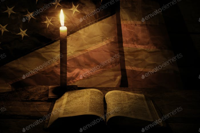 Old american flag and candle