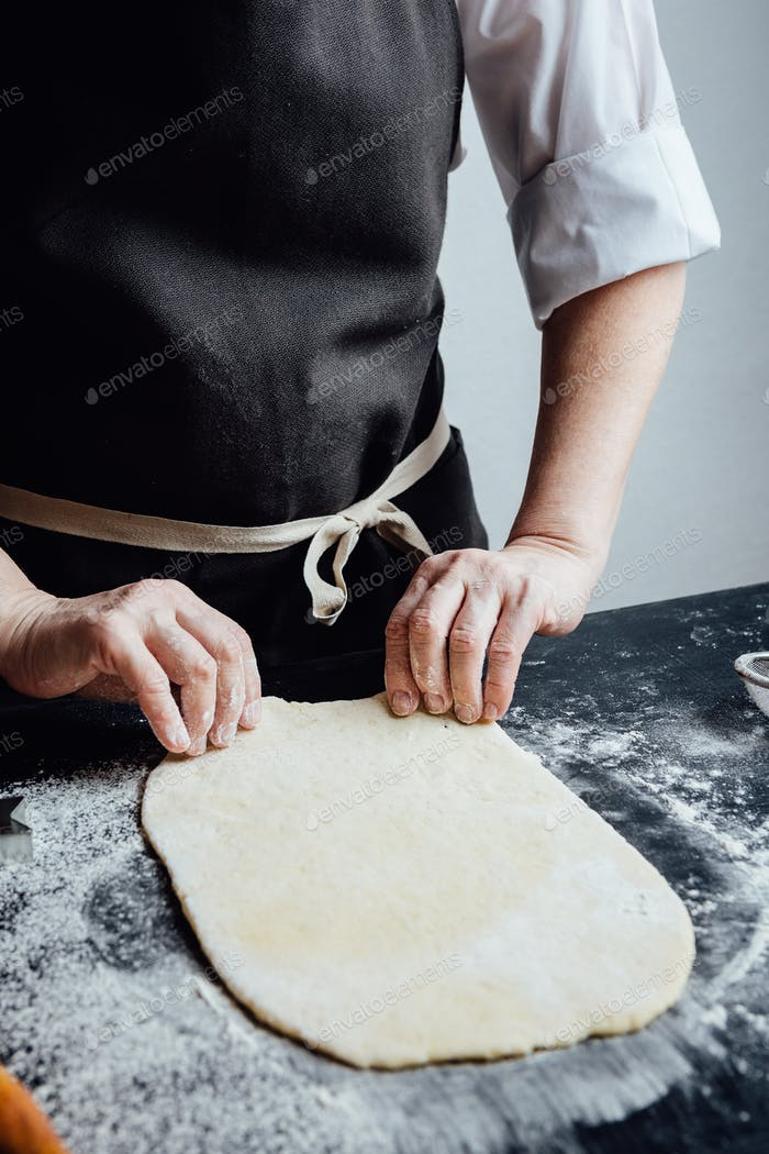 Person making shortcrust pastry