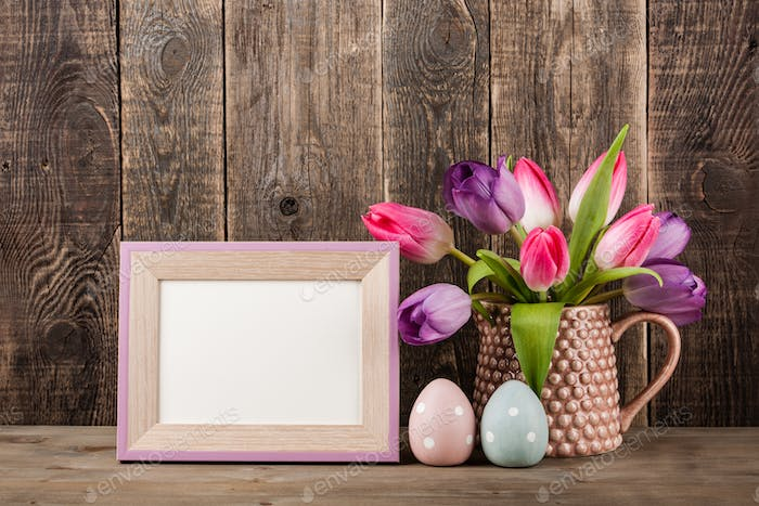 Easter decoration background with fresh tulips
