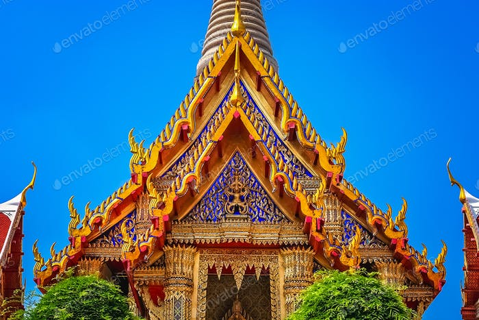 Ornate golden triangular roof of a Buddhist temple