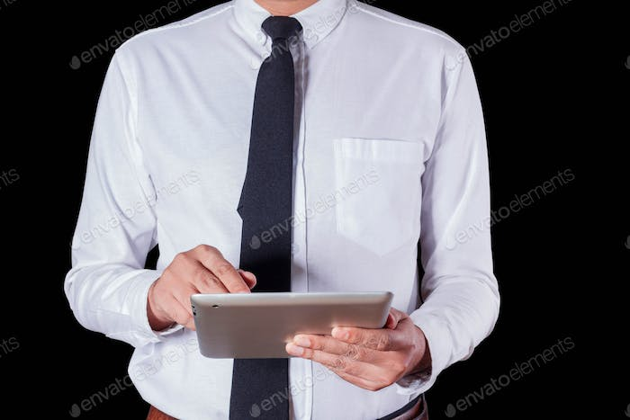 Man using tablet with black background