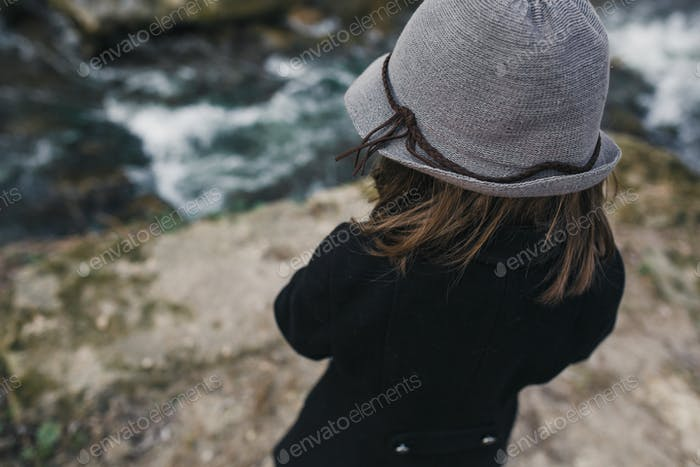 little girl in a black coat and hat