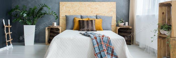 Grey and wooden bedroom