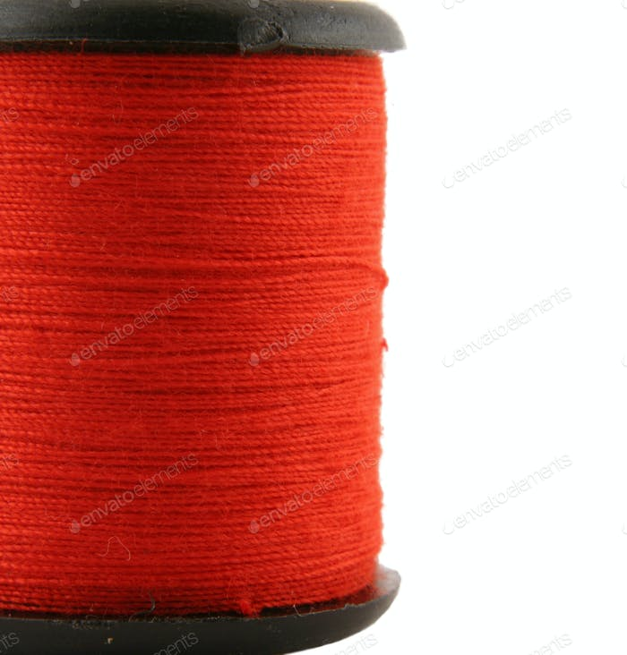 Red spool of thread