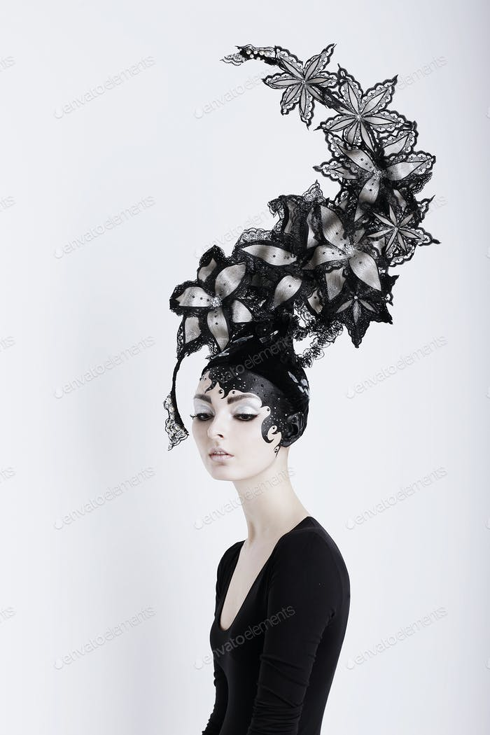 Creative Concept. Portrait of Futuristic Woman in Art Fabulous Headdress