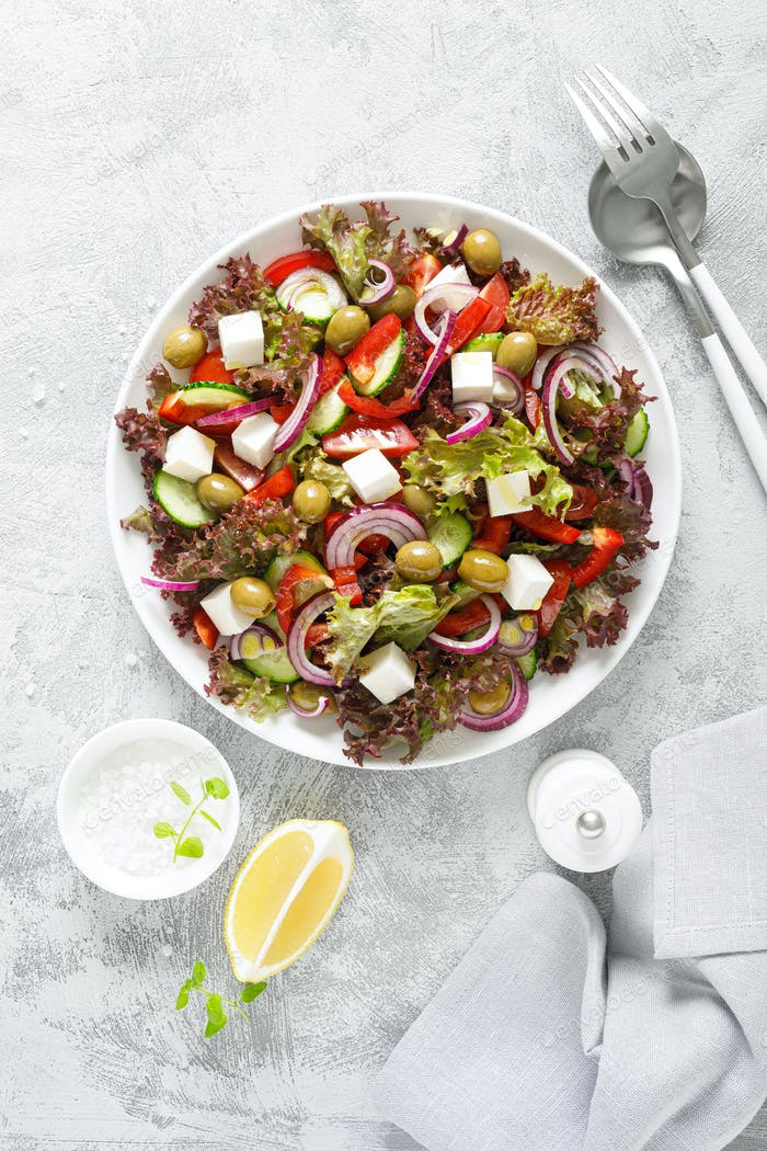 Greek salad with fresh vegetables, lettuce and feta cheese
