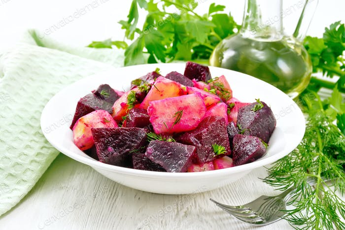 Salad of beets and potatoes in plate on table