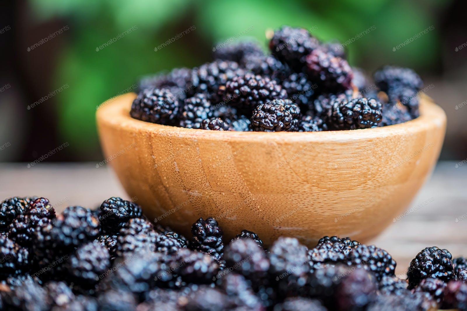 Fresh Mulberries Fruit In Wooden Bowl