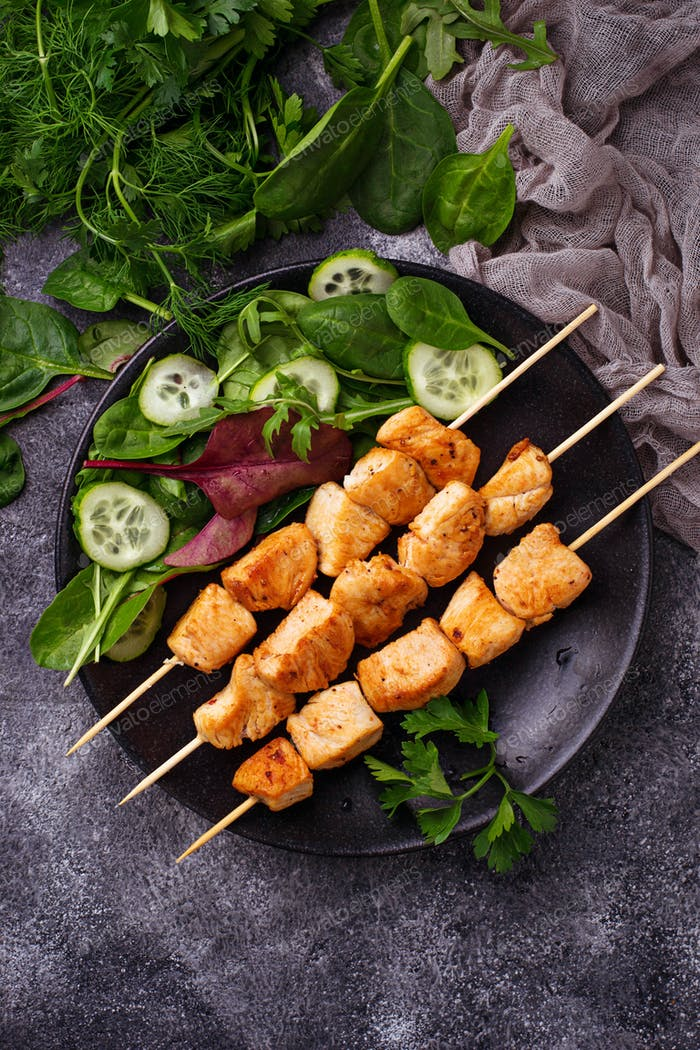 Chicken shish kebabs with green salad