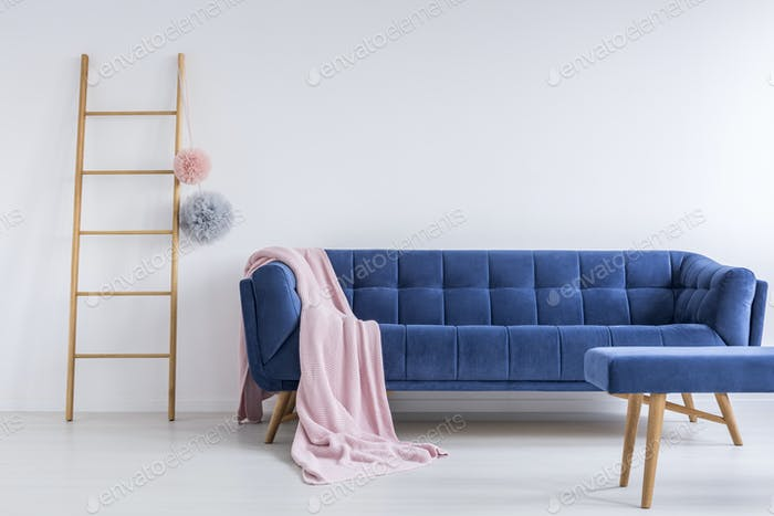 Blue sofa in white room