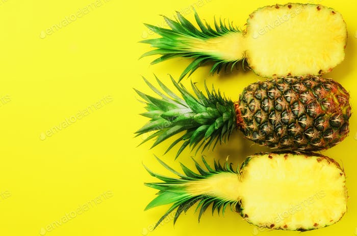 Pattern with bright pineapples on yellow background. Top View. Copy Space. Minimal style. Pop art