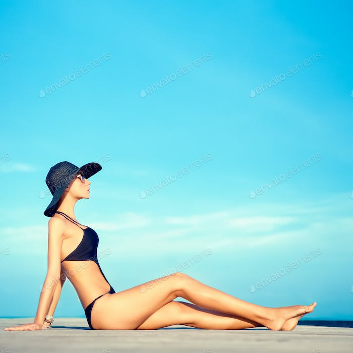 sensual fashion girl on holiday