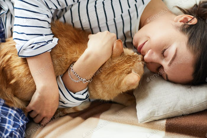 Young Woman Cuddling with Cat
