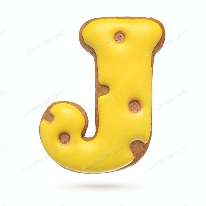 Großbuchstabe J gelber Lebkuchenkeks isoliert auf weiß.