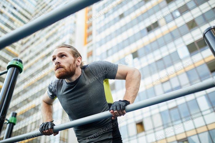 Bearded man doing pull-ups