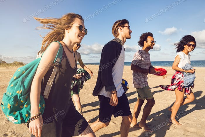 Multi-ethnic group of friends walking on the beach