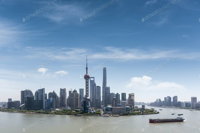aerial view of shanghai skyline and huangpu river with blue sky