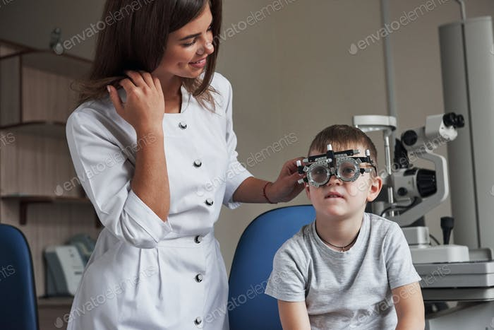 Reading the letters. Child sitting in the doctor's cabinet and have tested his visual acuity