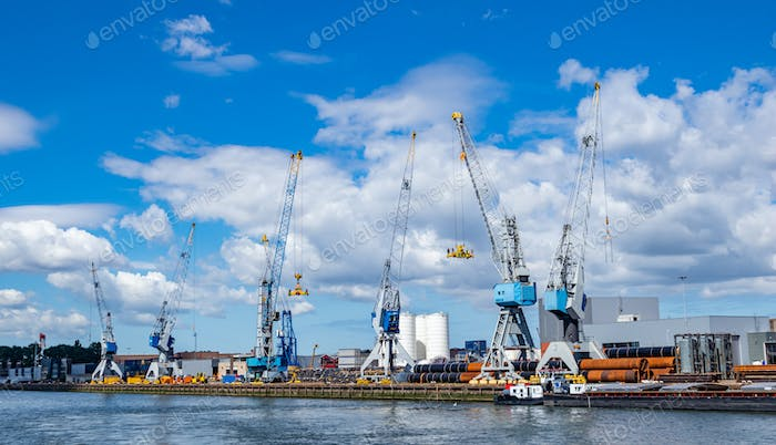 Cranes at port of Rotterdam, Netherlands. Logistics business, cargo loading unloading