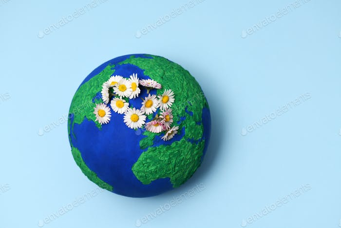 Earth model planet with daisies