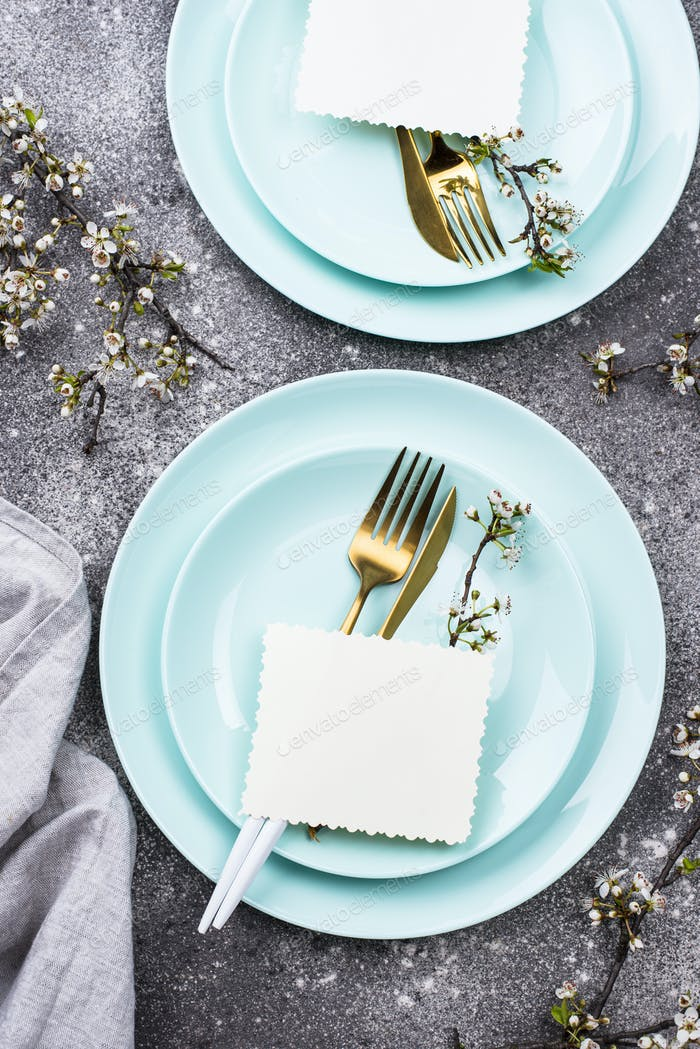 Spring table setting with blooming branch