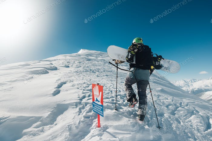 sportsman go with snowboard equipment