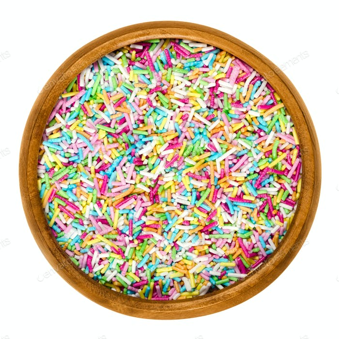 Colorful sugar sprinkles in wooden bowl