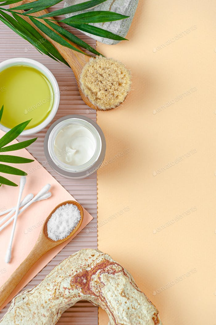 Cream and olive oil and body care products. Image with free space for text.