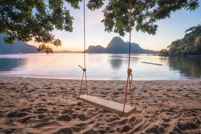 Swing on palm on paradise beach, El Nido, Palawan, Philippines