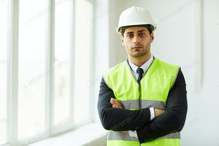 Middle-Eastern Businessman at Construction Site