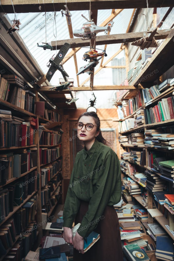 Portrait of woman with book looking camera