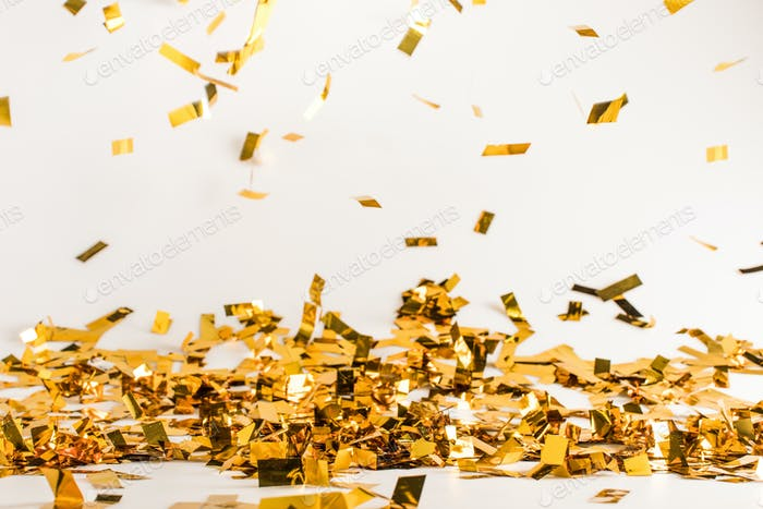 falling golden shiny confetti background