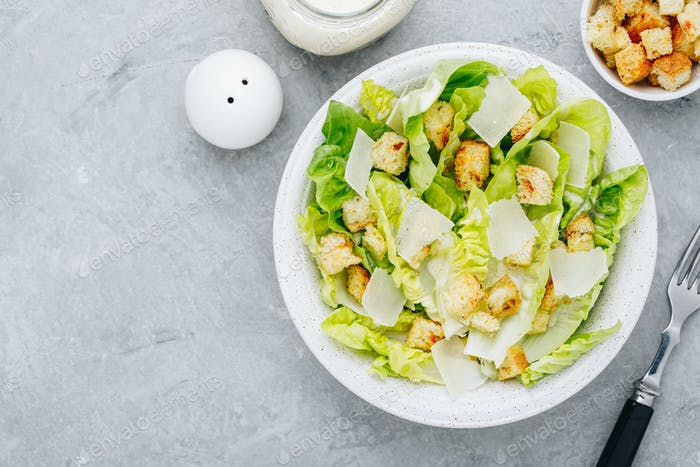 Classic Caesar Salad with Romaine Lettuce with Parmesan cheese and crunchy croutons.