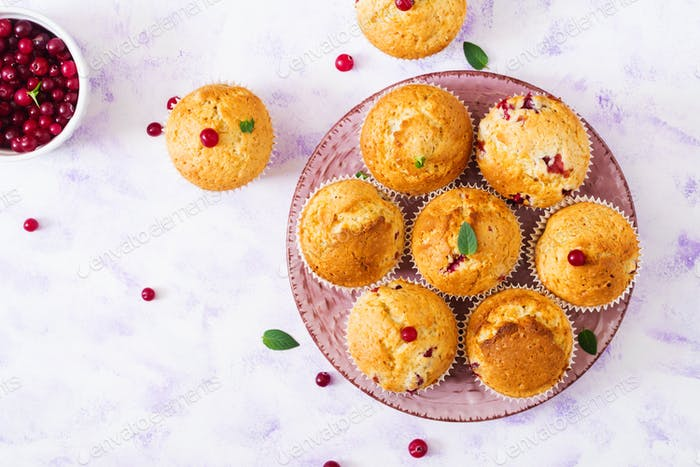 Tasty muffin (cupcake) with cranberries