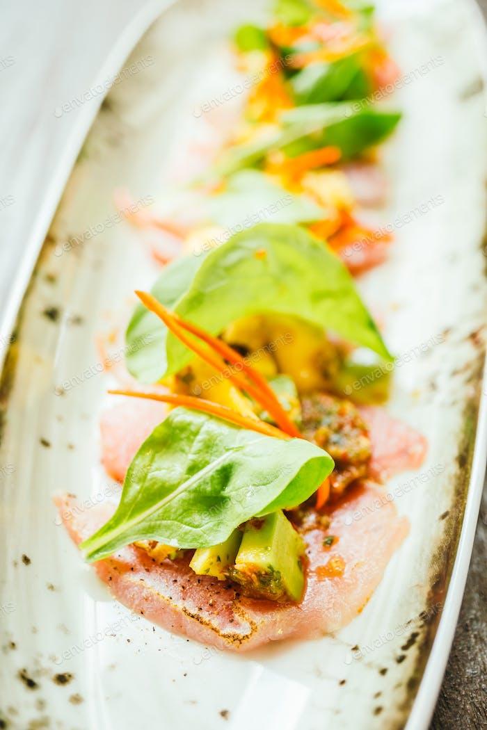 Raw fresh tuna fish meat salad with avocado and mango