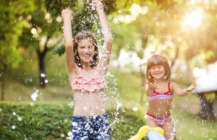 Two girls having fun outside