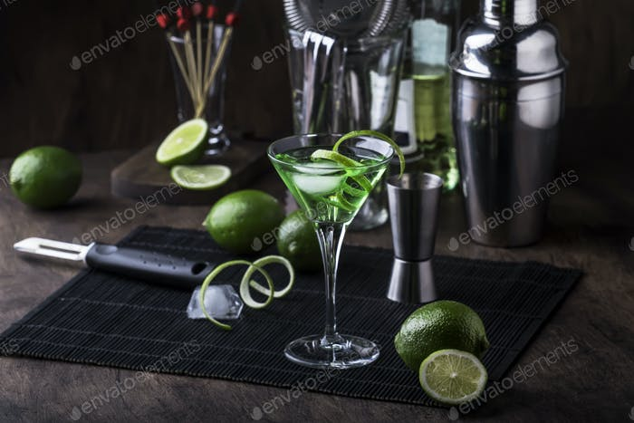 Green alcoholic cocktail martini glass with dry gin