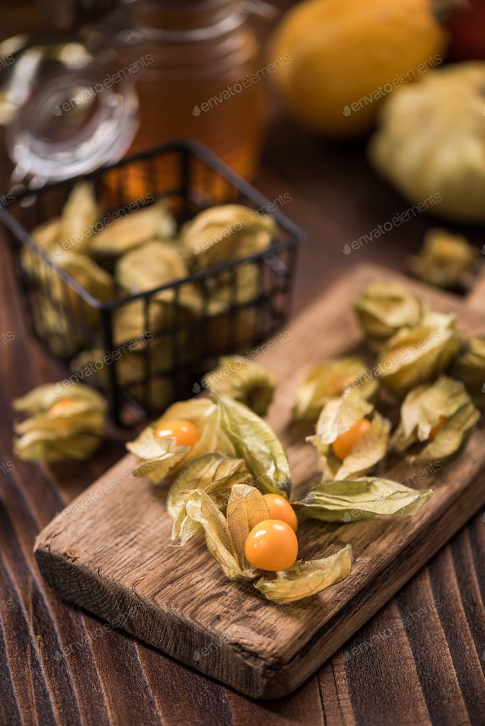Physalis fruits on wooden board