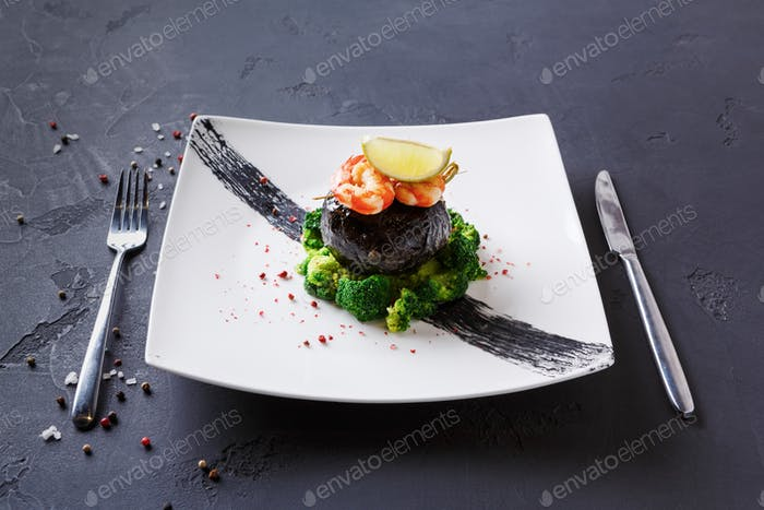 Modern restaurant food. Dorado fillet in nori with shrimps
