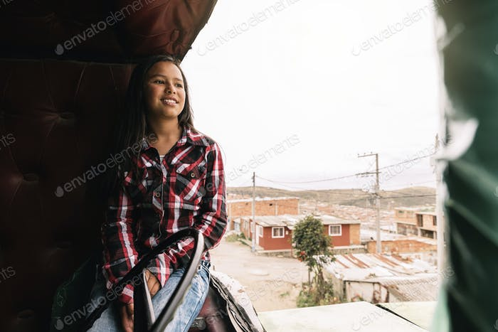 Cute girl playing in one abandoned truck.