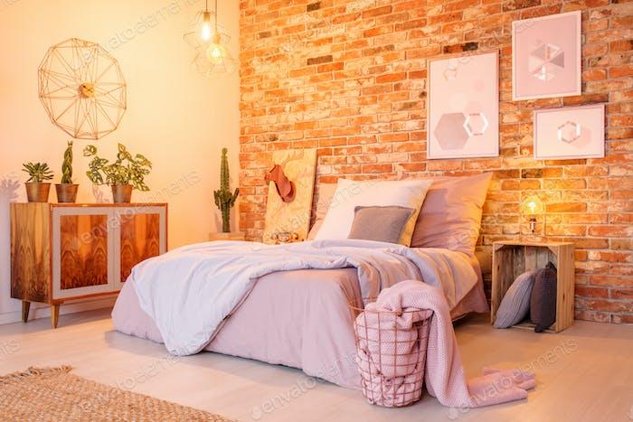 Warm bedroom with brick wall