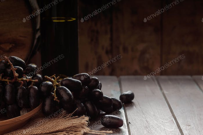 Grapes and wine on wooden